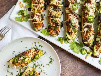 Barbecue Chicken Zucchini Boats Recipe + Photo via PEELWITHZEAL.COM