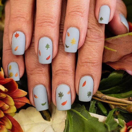 Best Simple Fall Nails Ideas! Light Blue Nails with Simple Autumn Leaves Design